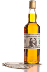 whisky and dollar money isolated on white