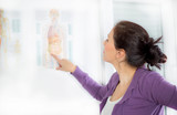 A woman looks at human anatomy posters