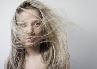 Young woman with long beautiful blond hair