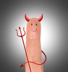 Devil on finger - humor contept