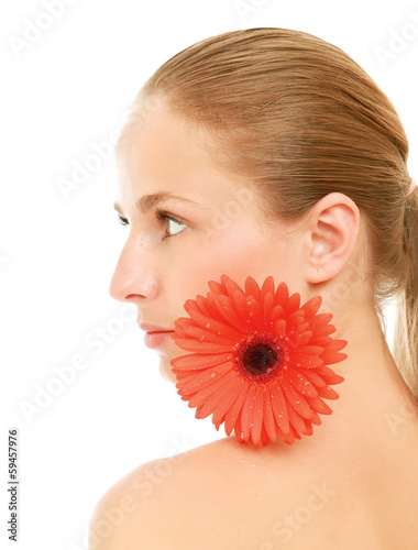 A beautiful young woman with a flower