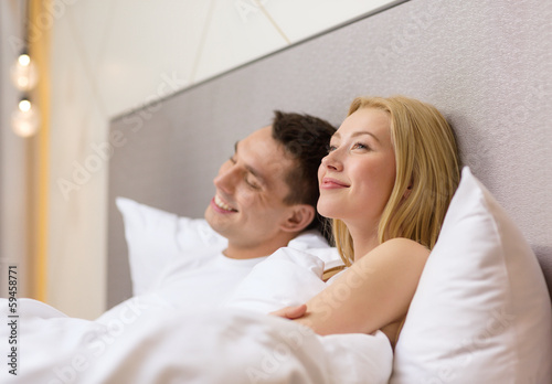 happy couple dreaming in bed