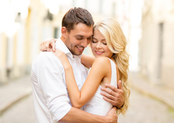 romantic happy couple hugging in the street