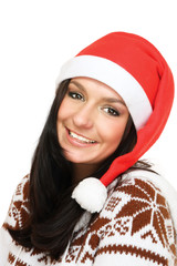 A smiling young woman in a Christmas hat
