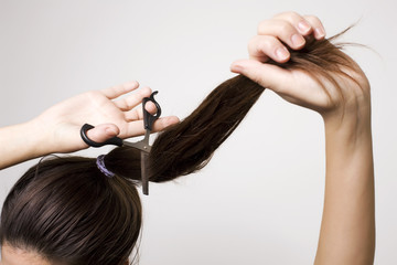 Woman cutting her ponytail