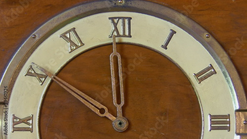 Antique clock close up, last minutes to midnight or noon