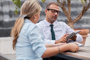 Businessman on wheelchair talks to his colleague