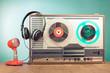 Reel to reel recorder, red microphone, headphones