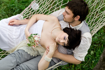 young couple Relaxing In spring Hammock