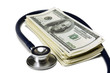 heap of dollars with stethoscope.