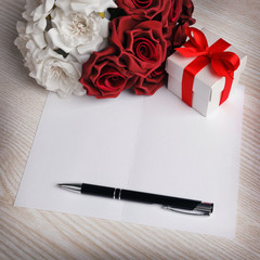 blank card with flowers and gift