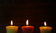 Burning candles on wooden background