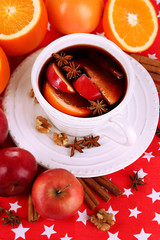 Fragrant mulled wine in bowl on napkin close-up
