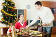 Man serving Christmas table