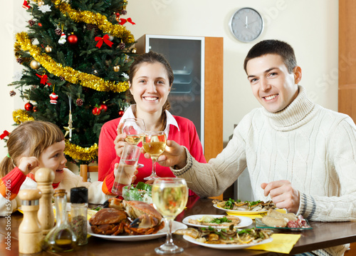 Happy family  celebrating Christmas  over celebratory table