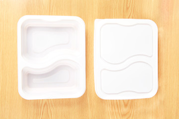 Plastic food box set on wood background .
