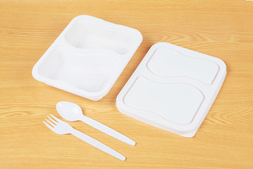 Plastic food box set on wood background .