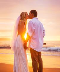 Bride and Groom, Enjoying Amazing Sunset on a Beautiful Tropical