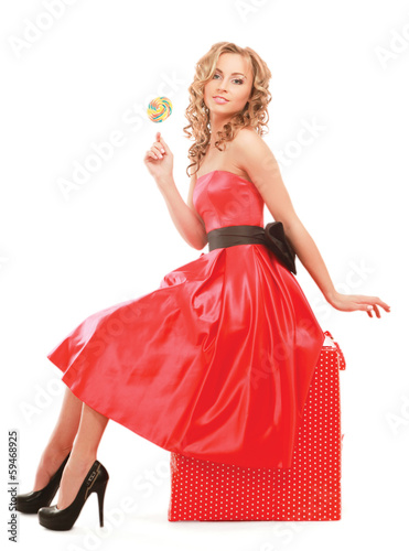 young happy woman with lollipop sitting.