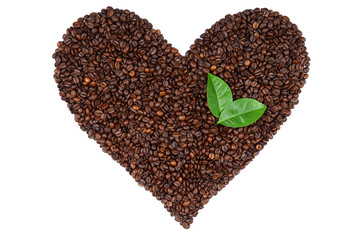 Heart made ​​from coffee beans and green leaves.