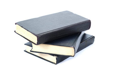 Stack of old books on a white background.