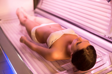 Woman on tanning bed.