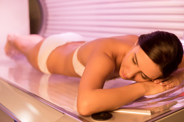 Beauty on tanning bed.