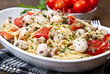 spaghetti con seppioline e pomodorini