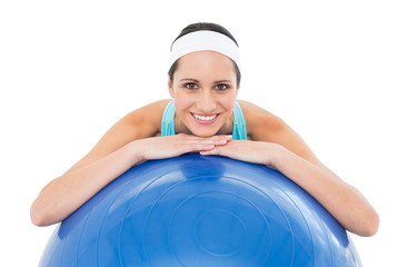 Portrait of a smiling fit woman with fitness ball