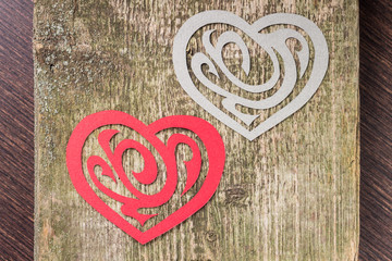 Two Paper Heart Ornamental Shape on wood
