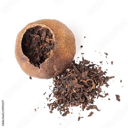 Tea Pu-erh packed in dried mandarin isolated on white