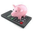 Cute pink piggy bank on calculator