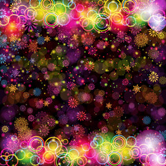 Christmas party background with colorful rings and snowflakes.