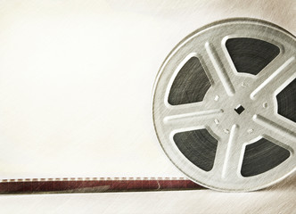 Old scratched motion picture film reel