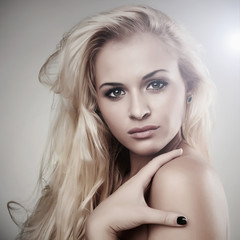 portrait of Beautiful blond woman. light background. beauty girl