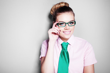 Beautiful nerdy young woman in glasses
