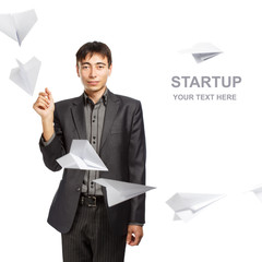 Businessman whit paper planes