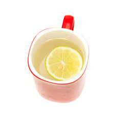 a glass with a lemon on a white background
