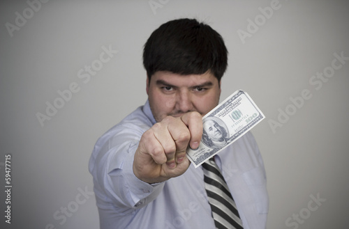 A Businessman Holds Money