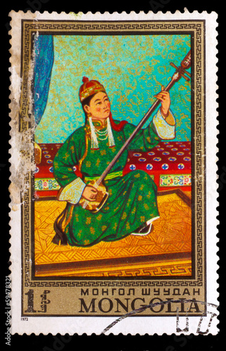 CIRCA 1972: A stamp printed by MONGOLIA , girl playin