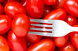 Fork and small  tomatoes