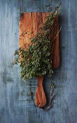 Dried wild oregano on a kitchen board