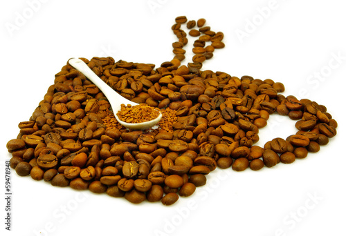 coffee beans and instant coffee in spoon on white background