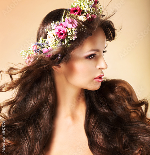 Young Auburn Woman with Long Flowing Hairs and Wildflowers