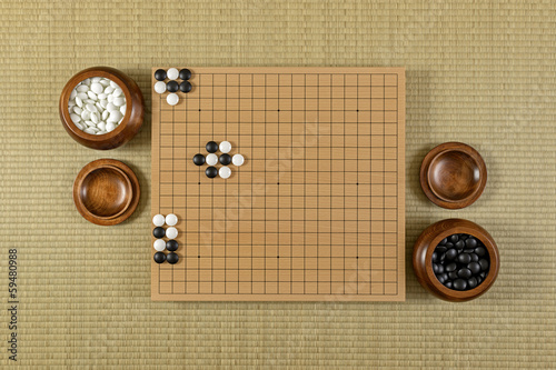 Go board on a Japanese tatami, showing varieties of KO
