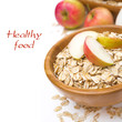 healthy breakfast - oat flakes with apples and a jug of milk