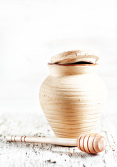Clay pot and wooden dipper