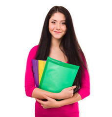 Cheerful young student with exercise books isolated on white