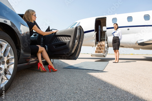 Leinwanddruck Bild Wealthy Woman Stepping Out Of Car At Terminal