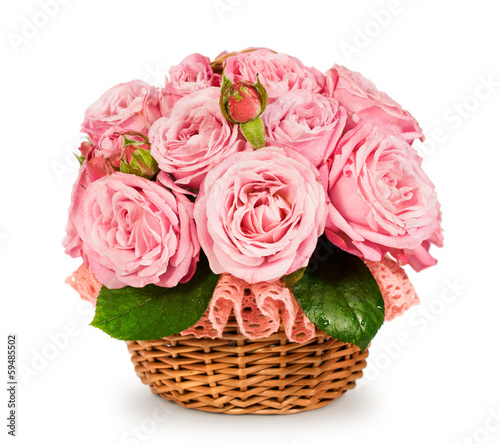 bouquet of pink roses in a basket